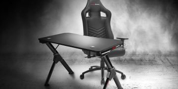 This gaming desk is perfect: it is foldable and has a support for helmets, and it is sold by Amazon